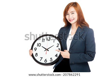 Asian businesswoman point to a clock  isolated on white background