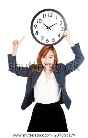 Asian businesswoman point to clock over head  isolated on white background
