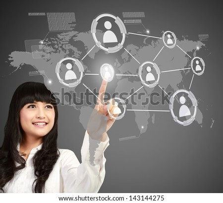 asian Businesswoman pressing button of social networking concept - stock photo