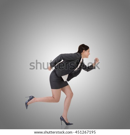 Asian businesswoman runing, side view full length portrait. - stock photo