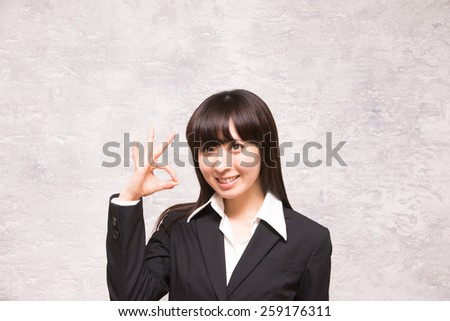 asian businesswoman showing okay sign - stock photo