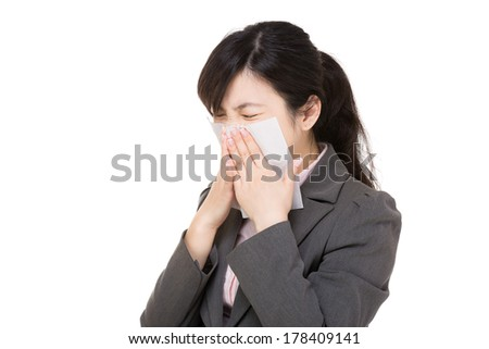 Asian businesswoman sneeze - stock photo