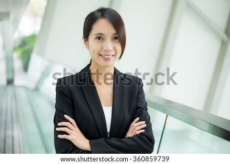 Asian Businesswoman standing at office