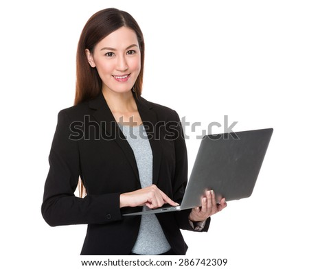 Asian businesswoman use of laptop computer - stock photo