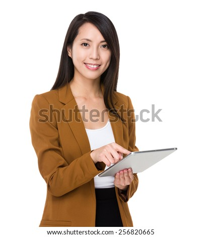 Asian businesswoman use of tablet - stock photo