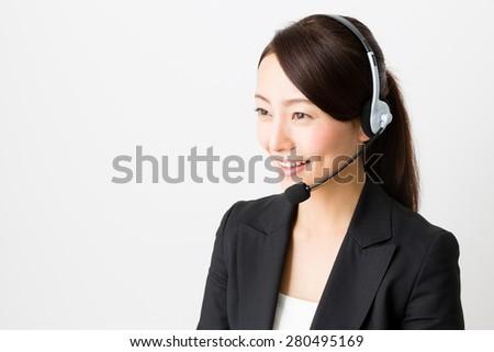 asian businesswoman using headset - stock photo