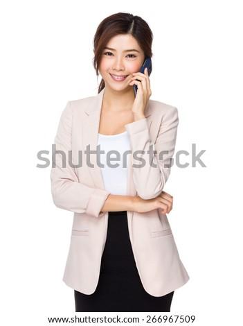 Asian businesswoman using smart phone - stock photo