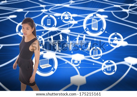 Asian businesswoman walking against glowing dots connected with lines