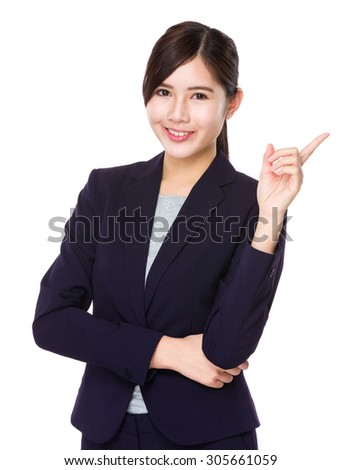 Asian businesswoman with finger point up - stock photo
