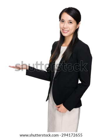 Asian businesswoman with hand showing blank sign - stock photo