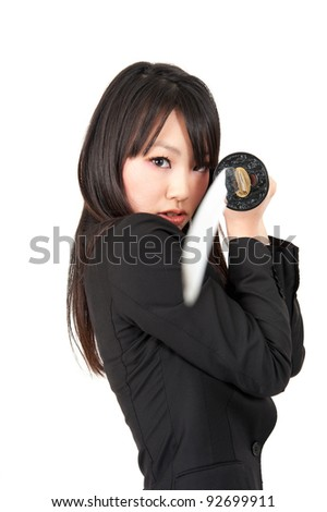 asian businesswoman with japanese samurai sword isolated on white background - stock photo