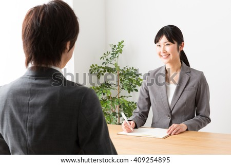 asian businesswoman working in the office - stock photo