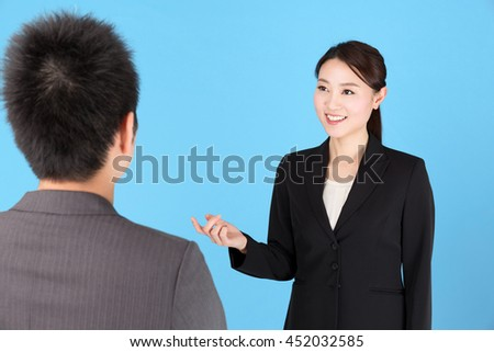 asian businesswoman working on blue background - stock photo