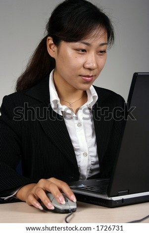 Asian businesswoman working with computer - stock photo