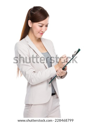 Asian businesswoman write on file pad