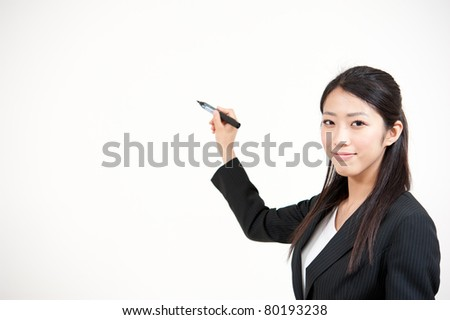 asian businesswoman writing by marker
