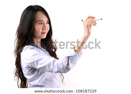 Asian businesswoman writing by marker pen on copy space white seamless background