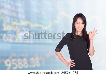 asian businesswomen 20-30 year old showing ok sign has background of airport .Mixed Asian / Caucasian businesswoman.Positive emotion - stock photo