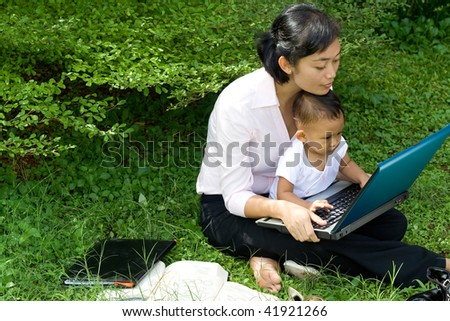 asian career woman give knowledge of a computer to baby girl - stock photo