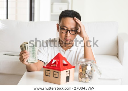 asian casual male and house loan - stock photo