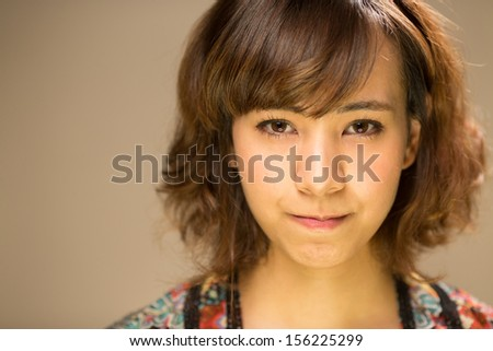 Asian caucasian mixed race young woman angry face