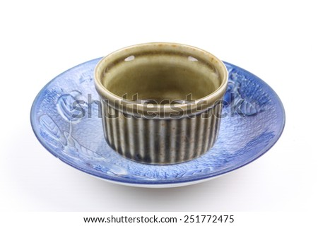Asian ceramics tea cups on white background