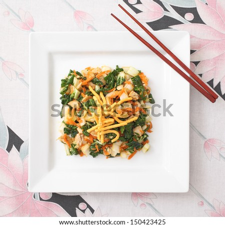 Asian Chicken Salad - Diced chicken breast tossed together with bok choy, grated carrots, and fried noodles  - stock photo