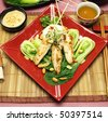 Asian chicken skewers on a bed of Chinese vegetables ready to serve. - stock photo