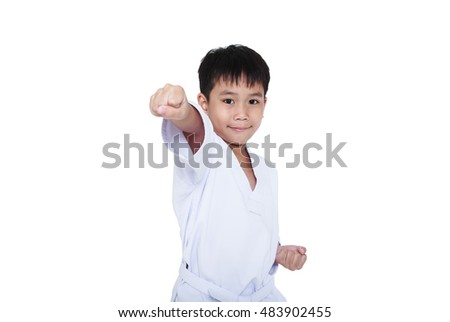 Asian child athletes martial art taekwondo training, isolated on white background. Cute boy with white belt in karate position, studio shot.
