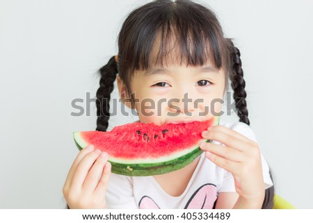 asian child eat watermelon