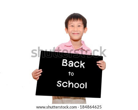 Asian child holding a black board with message Back to school on white background - stock photo