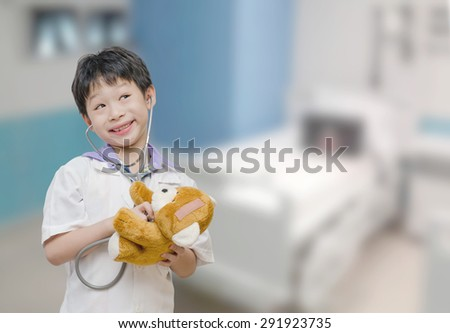 Asian child pretend to be doctor in hospital - stock photo