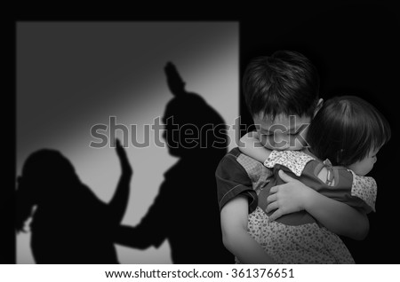 Asian child with his parent fighting in background,black and white color - stock photo