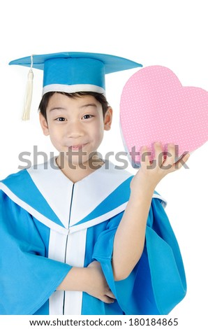Asian Child with pink heart box in Congratulations Kindergarten graduation uniform . - stock photo