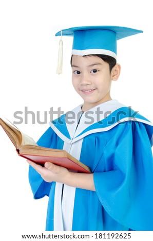 Asian Child with red book Kindergarten graduation uniform . - stock photo