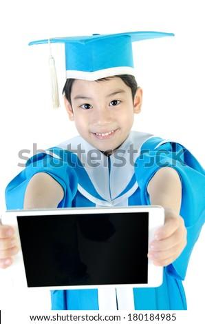 Asian Child with tablet computer in Congratulations Kindergarten graduation uniform onwhite background .  - stock photo