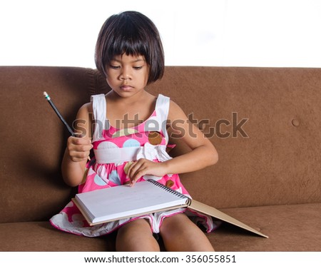 Asian Child Write a Note Book