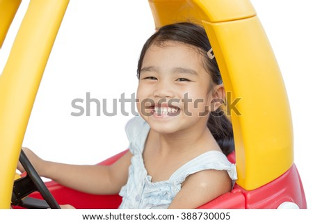 asian children girl driving toy car yellow - stock photo