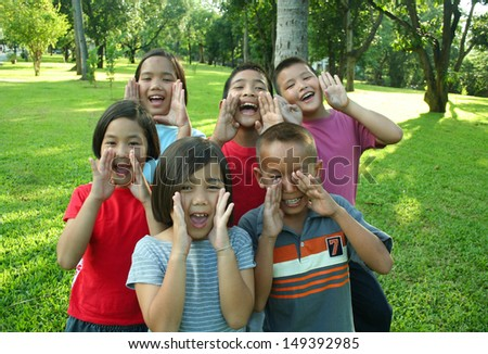 Asian children having fun in the park.  - stock photo