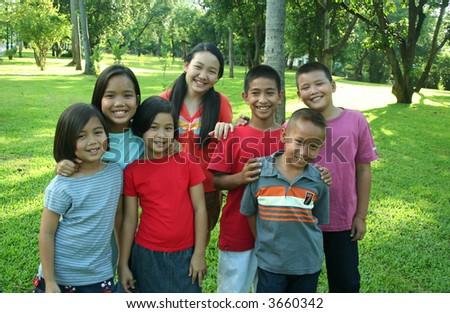 Asian children in the park. - stock photo