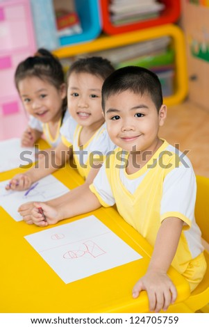 Asian children sitting in the studio - stock photo