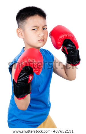 Asian Chinese boy wearing boxing gloves posing in isolated plain white background.