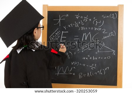 Asian Chinese children in graduation gown againts blackboard or chalkboard with formulas in plain isolated white background. - stock photo