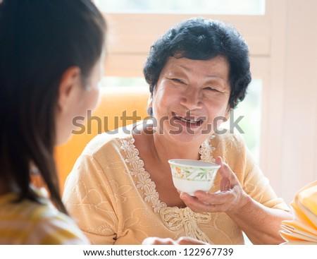 Asian Chinese family having breakfast in restaurant - stock photo