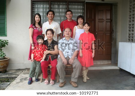 Asian chinese family's portrait in front of the house - stock photo