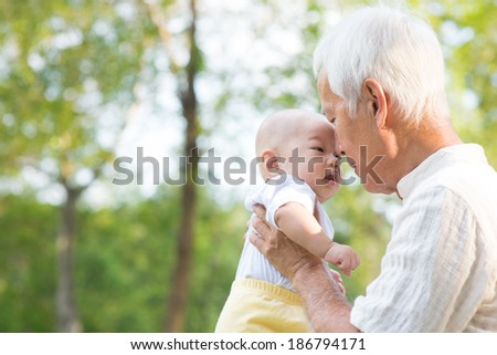 Asian Chinese Grandfather And Grandson Relaxing At Outdoor - stock photo