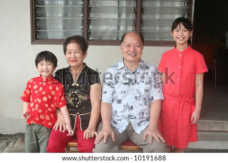 Asian chinese grandparents and grandchildren with cheongsam - stock photo