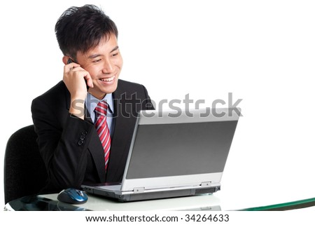 Asian Chinese/Japanese businessman shares a piece of good news with client over phone - stock photo