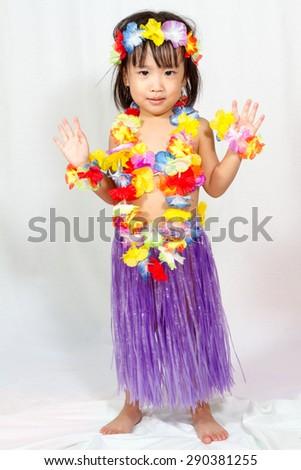 Asian Chinese little girl in hawaiian costume - stock photo