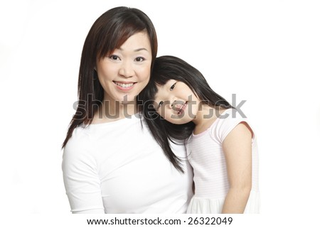 Asian Chinese mother and daughter posing and smiling happily isolated on white - stock photo